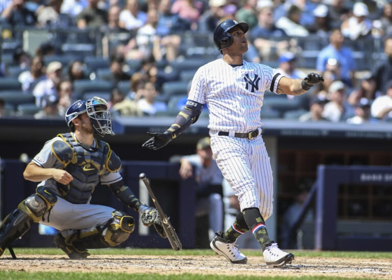 New York Yankees outfielder Aaron Hicks hits a home-run against the Tampa Bay Rays.