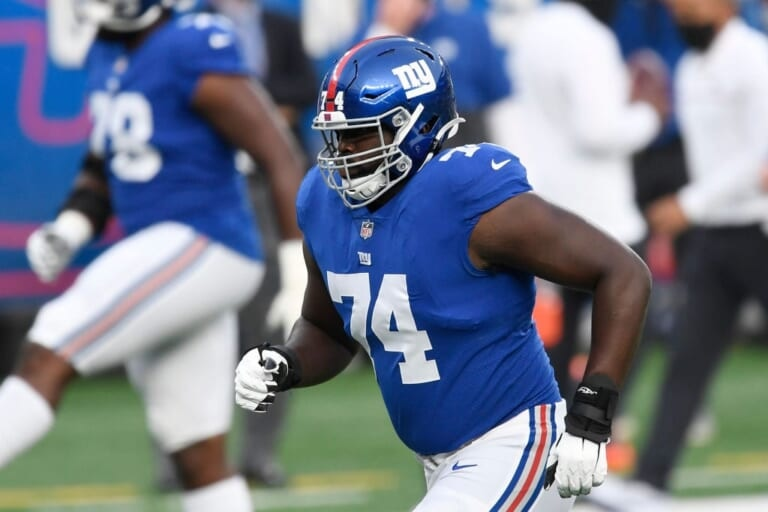 Who should start at right tackle for the New York Giants in 2021?